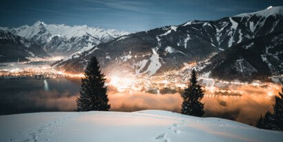 Mitterberg view at night of the sparkling Zell am See-Kaprun region in winter | © Zell am See-Kaprun Tourismus